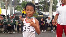 Usia Paling Kecil, Haza Juarai Lomba Lari 10 K