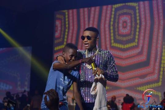 Wizkid signs 12 year old boy to star boy, gives him N10 million
