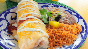 Eating lunch at Casa De Reyes, part of Fiesta De Reyes in Old Town San Diego: Suiza Shrimp Burrito, shrimp sautéed with onions, tomatoes and peppers, plus rice, cheddar and jack cheese and jalapeno aioli