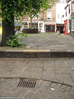 June 2013. Raised area from corner near Shambles entrance, looking towards Colliergate and phone box corner