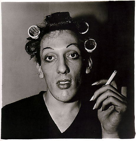 Diane Arbus, A young man with curlers at home on West 20th Street, N.Y.C., 1966, © The Estate of Diane Arbus. Courtesy of Masters of Photography