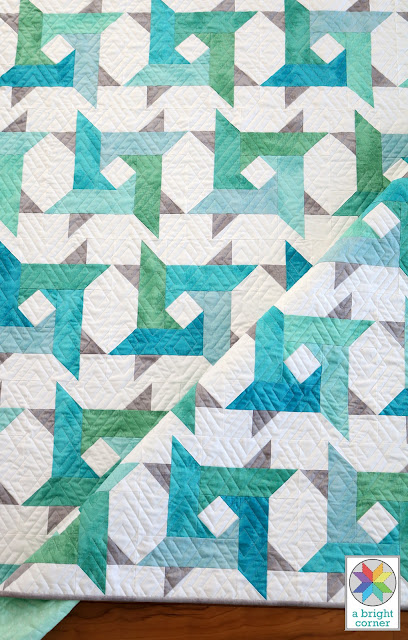 Windy City quilt pattern by Andy of A Bright Corner - precut friendly and great for using jelly rolls, layer cakes, fat quarters, or yardage. A fun modern twist on the traditional star quilt pattern