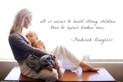 woman holds baby breastfeeding with a quote in the top right of the picture