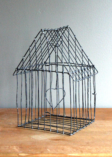 Small metal birdcage available for rent from www.momentarilyyours.com, $2.00.