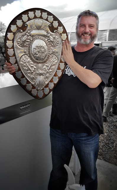 Photo of Mike Riversdale holding the Ranfurly Shield