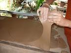 cutting the slab of clay
