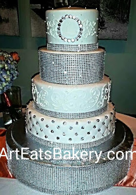 Four Tier Round White Wedding Cake With Royal Icing Curly Q Piping Diamond And Boston Rhinestones Monogram Bling Ribbons Stand