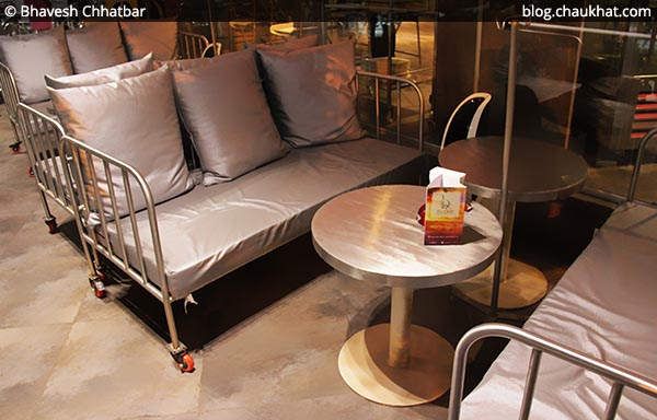 Hospital beds arranged as sofas in the outdoor seating area at SocialClinic Restobar located at Koregaon Park in Pune