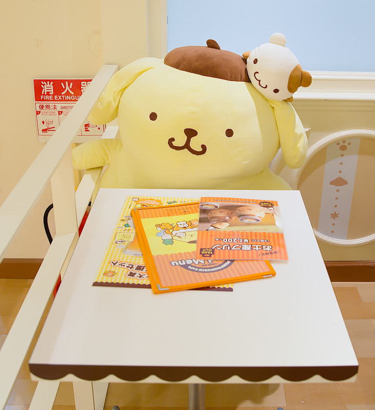 photo of a table with a large stuffed character in the chair