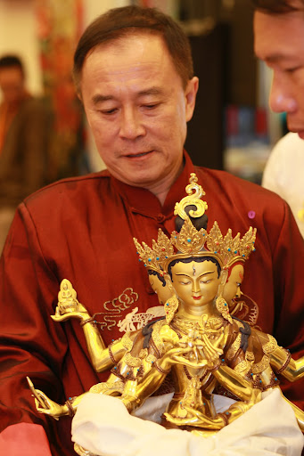 Hup Cheng offering long life statue during long Life puja in Singapore, March, 2013.