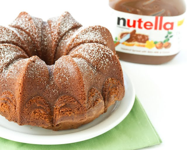 photo of a Nutella cake dusted with powdered sugar