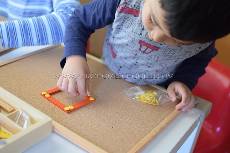 Using Montessori Geometric Sticks to form shapes