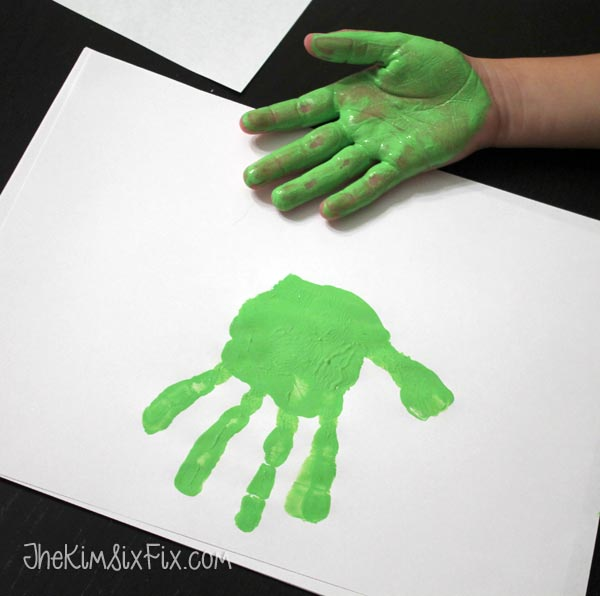 Green childs handprint