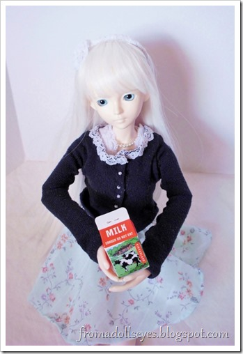 A ball jointed doll holding a milk carton.  It's an eraser.