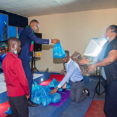Church members kneel down to welcome their pastor Prophet Ian Genesis the founder of Charisma Ministries in Lusaka Zambia, SD News Blog, Christianity in africa, religious bigotry in Africa,