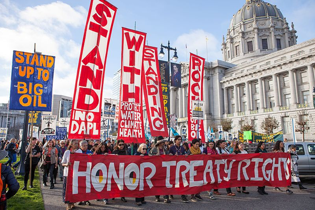 People protesting the Dakota Access Pipeline march past San Francisco City Hall, 15 November 2016. Photo: Pax Ahimsa Gethen