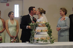 A good looking kiss after cake. Photo by Nick Peyton, taken August 8, 2006.