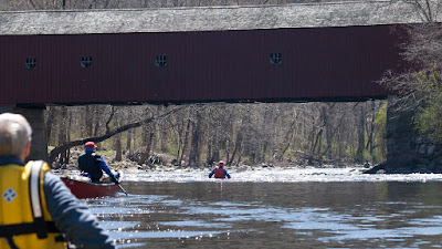 Dropping into the rapids at  west cornwall covered bridge.