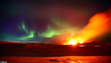 Photo: Stunning pictures show Northern Lights over erupting Icelandic volcano  More info  http://www.dailymail.co.uk/sciencetech/article-1290776/Northern-Lights-erupting-Icelandic-volcano.html  Photographer James Appleton, 23, from Cambridge