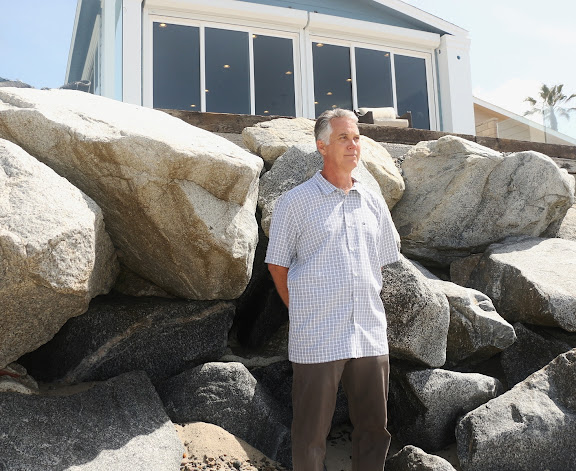 Government prevents homeowners from rebuilding seawall as erosion sets in