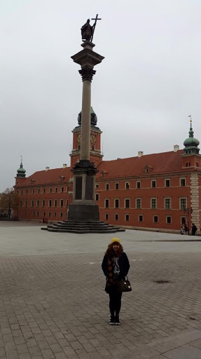 Posing in front of Sigismund's Column in Warsaw Poland