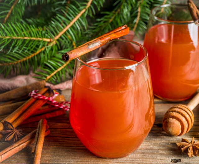 Two glass-mugs filled with hot wassail