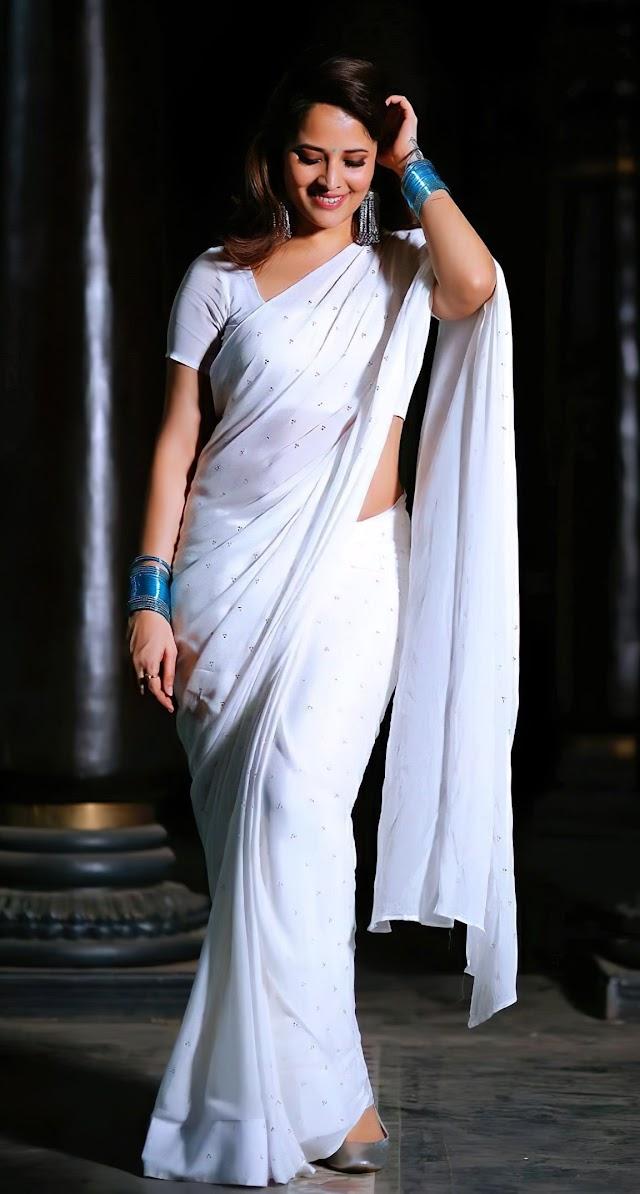Tv anchor Anasuya in white transparent saree