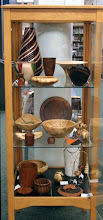 Photo: Phil Brown artfully arranged 24 pieces of turned wood art, loaned by MCW Members, in this case at the Twinbrook Public Library at 202 Meadow Hall Drive in Rockville, MD. (front view)