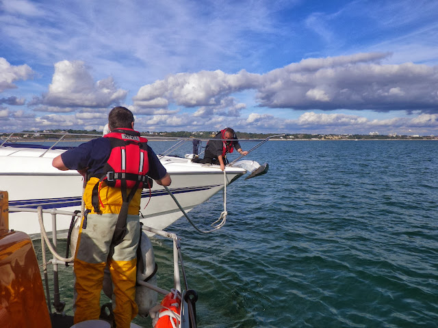 Poole lifeboat Crew Member Ade gently feeding out the tow rope from Poole ALB 6 October 2013 Photo: RNLI Poole/Anne Millman