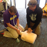 Crew Members Scott and Joe carrying out CPR and assisted breathing on a child manikin during a Casualty Care course - July 2014 Photo: Dave Riley