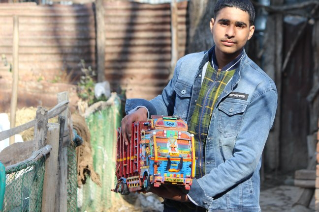 16 Years old boy making different types of small vehicle toys from waste materials in Pulwama  Pulwama : A 16 years old boy, Shahid Ul Islam from Thiker Pora in South Kashmir's Pulwama district is making use of waste materials in making different kinds of toy vehicles. Shahid is interested in this art from seventh class and till now he has made different types of small vehicles like trucks, army casper and thor. Despite living in poverty, Shahid is hopeful that administration will help him to make his dream true.  Shahid while speaking to TEN , said that if administration would help for in this then he is going to carry this art for full lifetime otherwise it would be a waste of time to go further with this art.  Shahid's father also appealed administration to help his son so that he can fullfill his dream.  He is hopeful that his son will bring laurels to his village and to whole Jammu and Kashmir only if administration will show any interest in his art.