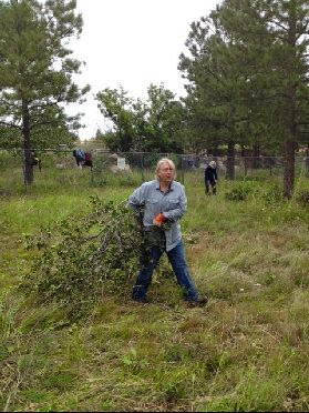 460' of Fence Line Clearing Sept 2014: Nanci removing brush while Sandy cleans up with the loppers. Couldn't get it done with out these ladies!