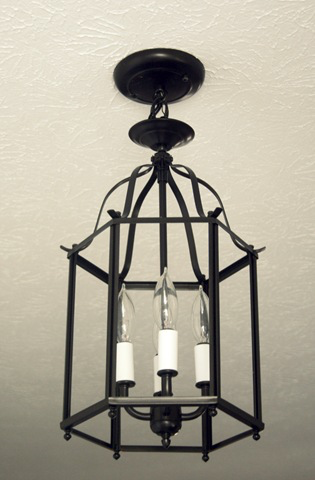 Brass dated fixture to traditional black lantern