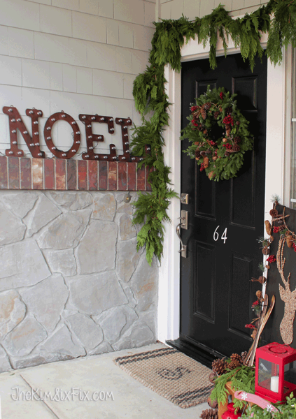 Front door with Noel Marquis sign