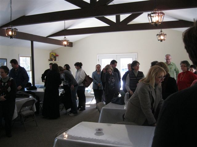 Attendees await the beginning of the retreat.