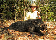 Dr Jason Patera with an exceptional wild boar. The tusks on this boar are huge, they don't come much better.