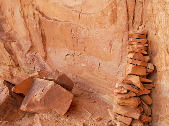 Pictographs and a rock tower built to provide access to the ledge above
