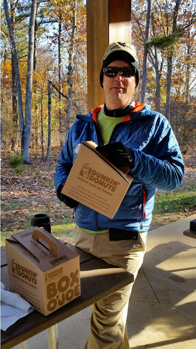John is ready to keep runners warm with lots of coffee.