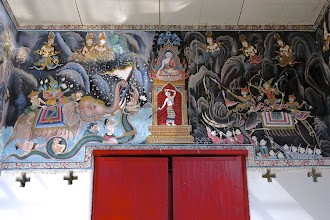 Photo: the scene of Buddha's enlightenment with Earth Mother Goddess as the witness, above a doorway in Wat Sutone