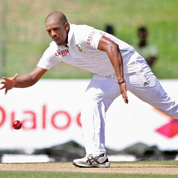 South African bowler Vernon Philander tries to stop the ball during the first day of the second test cricket match between Sri Lanka and South Africa in Colombo, Sri Lanka, Thursday, July 24, 2014.