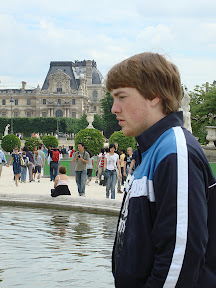 Watching kids play with sailboats in the fountain at The Louvre