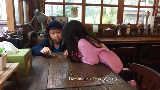 the kids examining the coins that they had