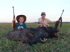 2 happy young hunters with 2 good wild boar, Carmor Plains