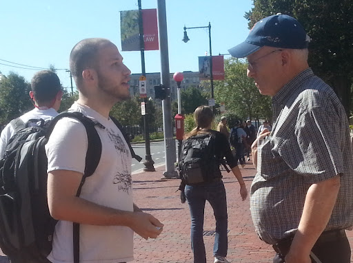 Please PRAY for Joshua (on the left of the photo). He is one of THE MOST HOSTILE people I have ever encountered. He was part of the fiasco last year where I almost got arrested. He came right up to our team at Boston University and started arguing VERY AGGRESSIVELY. In this photo, my friend Ray is attempting to reason with him.