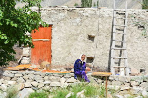 Women in Hunza is drying appricots, Gilgit Baltistan