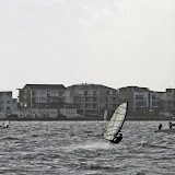 A windsurfer makes the most of the gusty conditions in the harbour - 27 October 2013.  Photo credit: Mike Millard