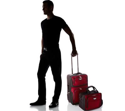 penumpang dengan 1 tas bagasi dan 1 tas tangan
