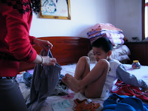 Photo: baby son, warrenzh, 朱楚甲 prepared for the eve of lunar Spring Festival, trying to avoid been shot in photo.