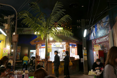 All around the Momofuku Ando Instant Ramen Museum Noodles Bazaar eating area are multiple booths with various kinds of ramen from around the world to try in a setting like an outdoor food court market