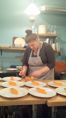 Maya plating the Sweet potato custard pie, the final course